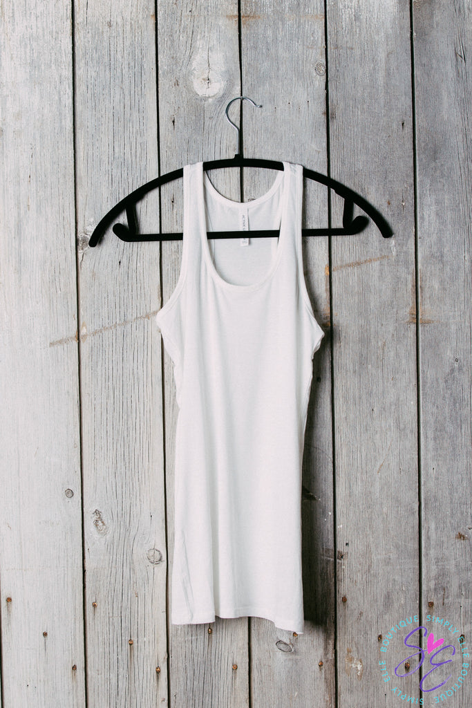 Basic racer back tank top. Perfect to wear under cardigans, kimonos or tank tops. 95% cotton 5% spandex