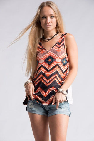 Aztec print sleeveless top with lace back.