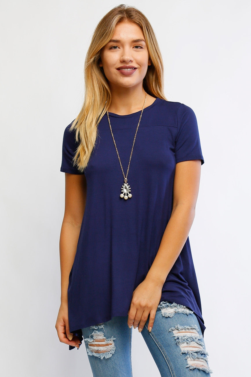 Navy. Short sleeve round neck shark bite tunic top.