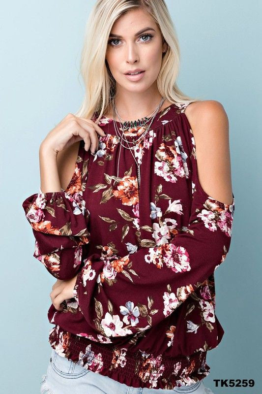 Floral print jersey cold shoulder top with u-neckline and keyhole back with elastic waist.