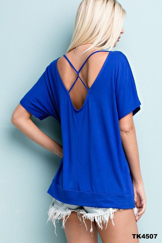 Premium bamboo knit dolman top features deep v-neck back with criss cross detail.