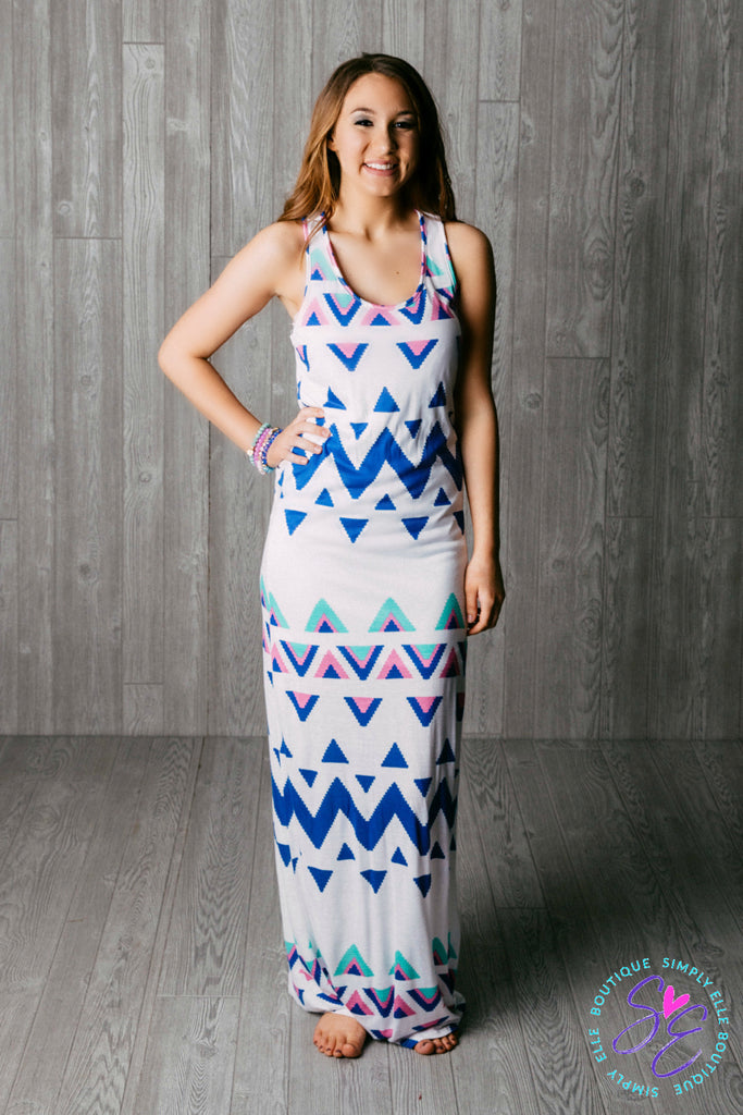 Long white maxi dress with blue chevron details.