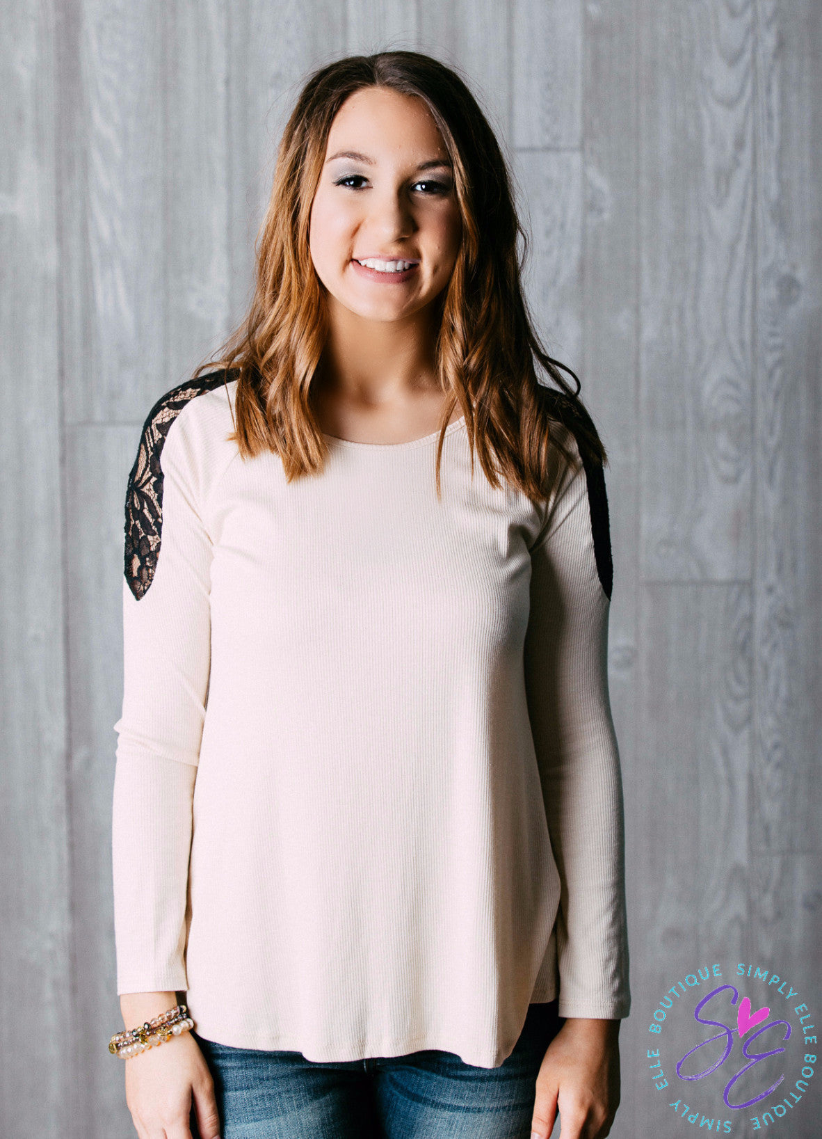 Long sleeve Ivory Lace Top. Black arm and neck detailing.