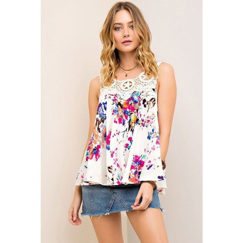 Floral print tank top with magenta accents.  Lace details on top. Flowy.