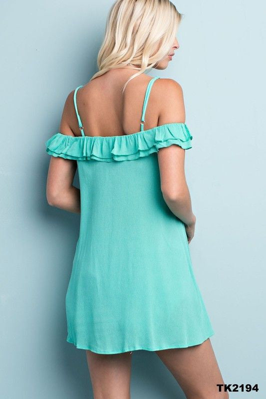 Leave the shoulders bare in this bardot style, off-the-shoulder top. This top has romantic feel with a high-low hemline and soft ruffle detail made with a textured crepe jersey fabric.