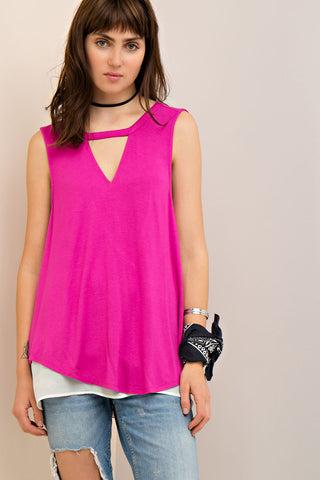 Solid scoop-neck top featuring cutout at front. Contrast woven fabric at back with cutouts and button closure. Round hem. Non-sheer. Knit. Lightweight.