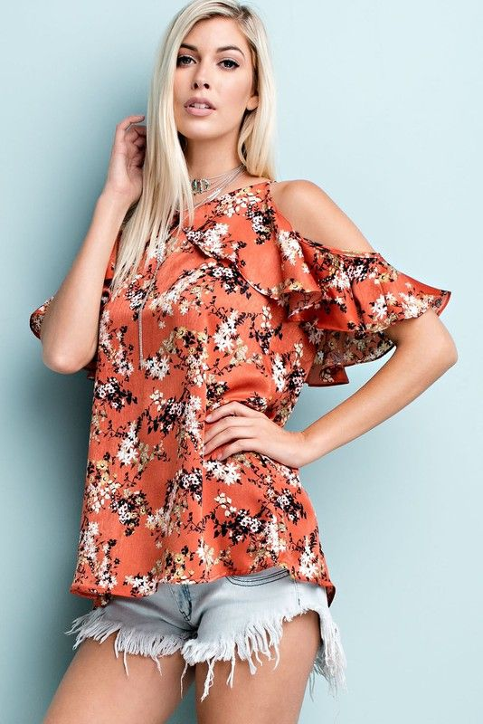 Floral print. Satin, cami top features a ruffled aesthetic with neck and sleeve overlay.