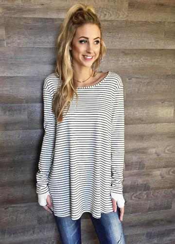 This long sleeve stripe tunic top combines this season's trendiest styles!