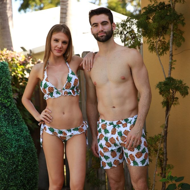 Women and men matching swimsuits - pineapples - couple