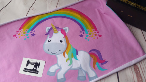 Rainbow unicorn on solid pink organic knit panel, 19x15 inches, sold per panel.