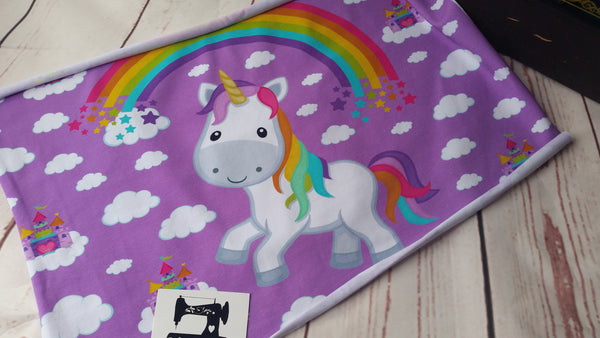 Rainbow unicorn on purple cotton lycra panel