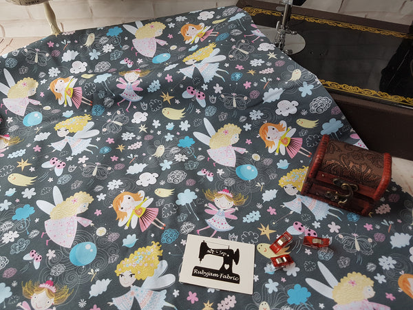 Fairy Fun on Charcoal Grey - cotton lycra - 170cm wide