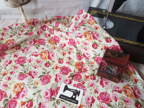 Pink floral on cream cotton lycra 4 way stretch knit fabric