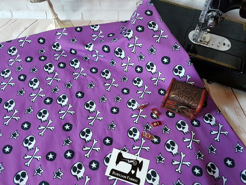 Skulls on Purple - cotton lycra - 170cm wide