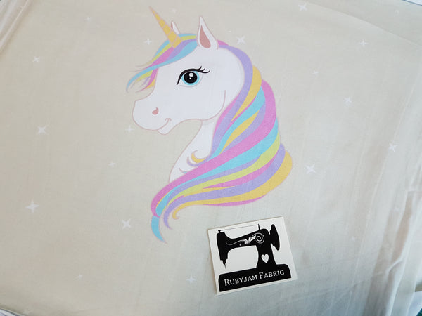 Pastel Unicorns - tossed - cotton lycra - 150cm wide