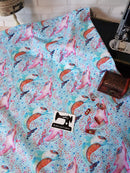 Dolphins on Blue - cotton lycra - 150cm wide - clearance
