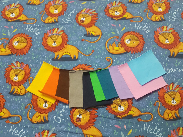 Storytime Lions Blue - cotton lycra - 150cm wide