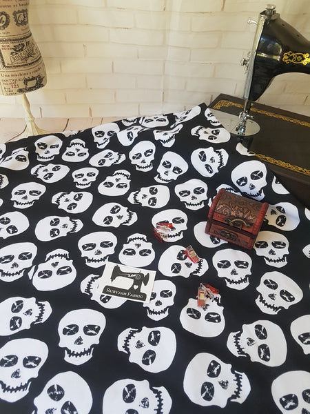 White Skulls on Black - cotton lycra - 150cm wide