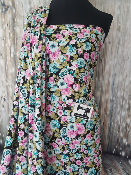 Spring Floral on black - cotton lycra - 150cm wide - clearance