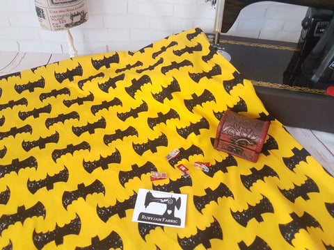 Black Grunge Bats on Yellow - cotton lycra - 150cm wide