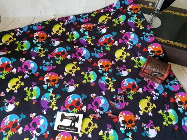 Bright Rainbow Skulls - cotton lycra - 150cm wide