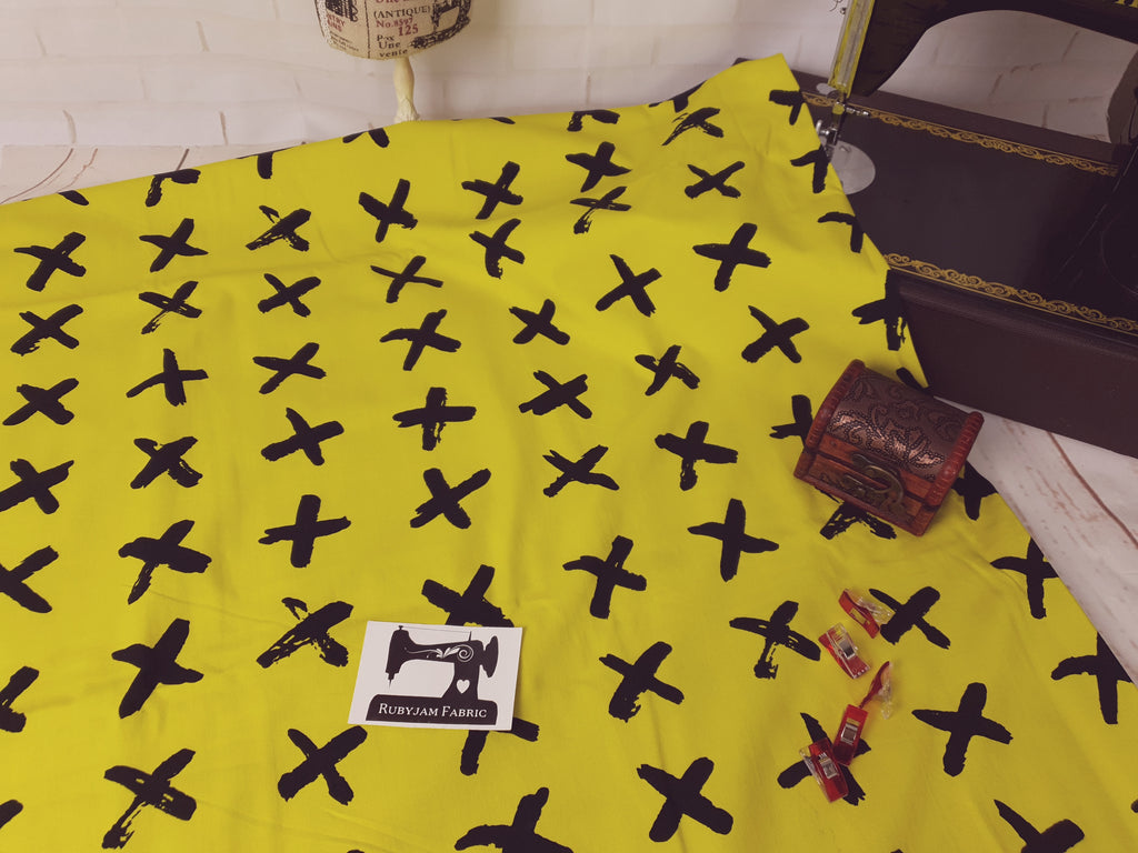 Black Crosses - Yellow - cotton lycra - 150cm wide
