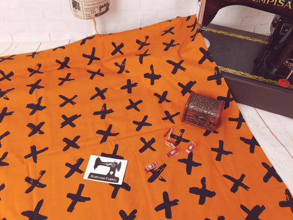Black Crosses - Orange - cotton lycra - 150cm wide