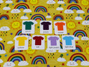 Rainbows on Yellow - cotton lycra - 150cm wide