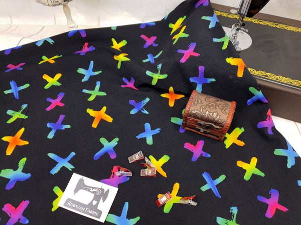 Rainbow Crosses on Black - cotton lycra - 150cm wide