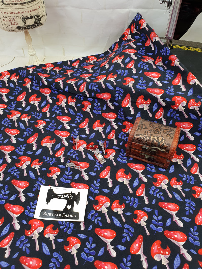 Red Mushrooms - cotton lycra - 150cm wide
