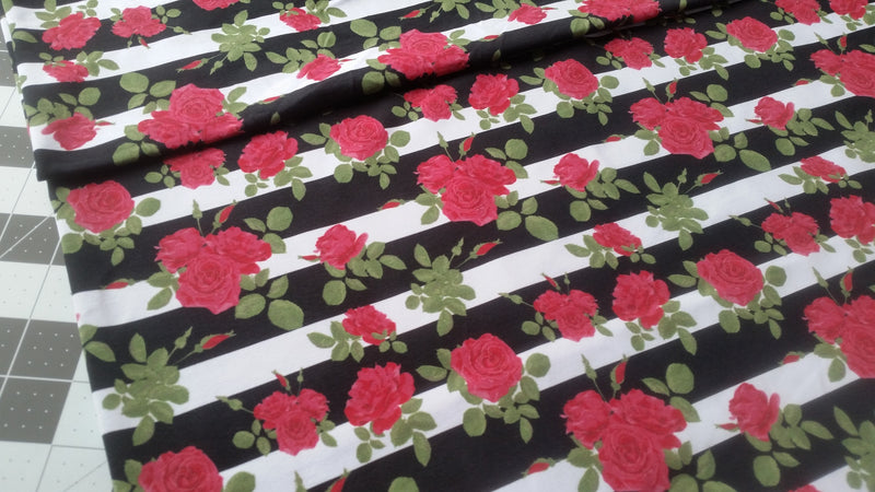 Roses on black/white stripes poly lycra - SWIM KNIT - 4 way stretch knit fabric - 150cm wide