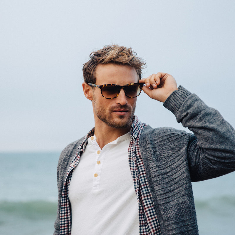 Parker wears the Bay in Turtle with Brown Fade sunglass lenses