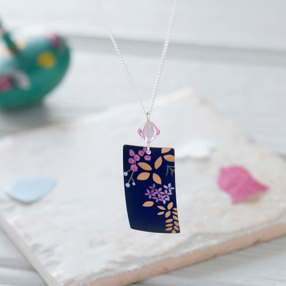 kyoto blue purple aluminium rectangular pendant with pink Swarovski crystal on a 18 inch sterling silver curb chain made from treasured tins