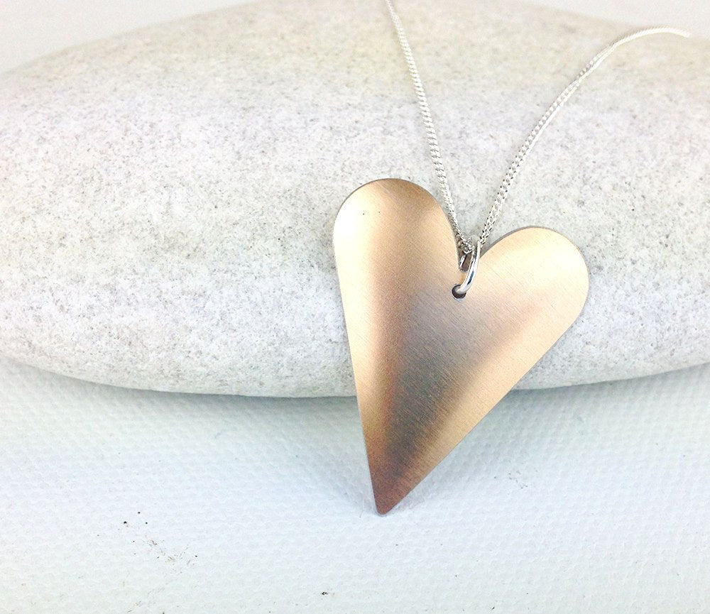 copper-coated aluminium heart pendant necklace on a 18 inch sterling silver curb chain made from treasured tins