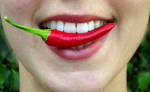 Why do people react differently to spicy foods?
