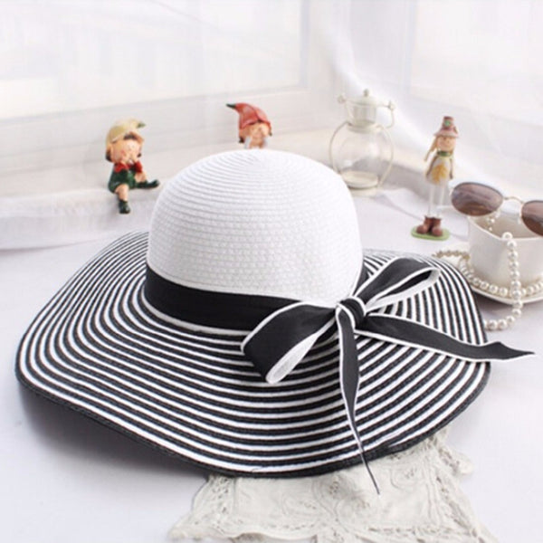 2016 New Fashion Hepburn Wind Black White Striped Bowknot Summer Sun Hat Beautiful Women Straw Beach Hat Large Brimmed Hat