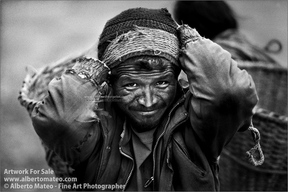 Porter carrying stones, Himalaya. | Black and White Portrait Print.
