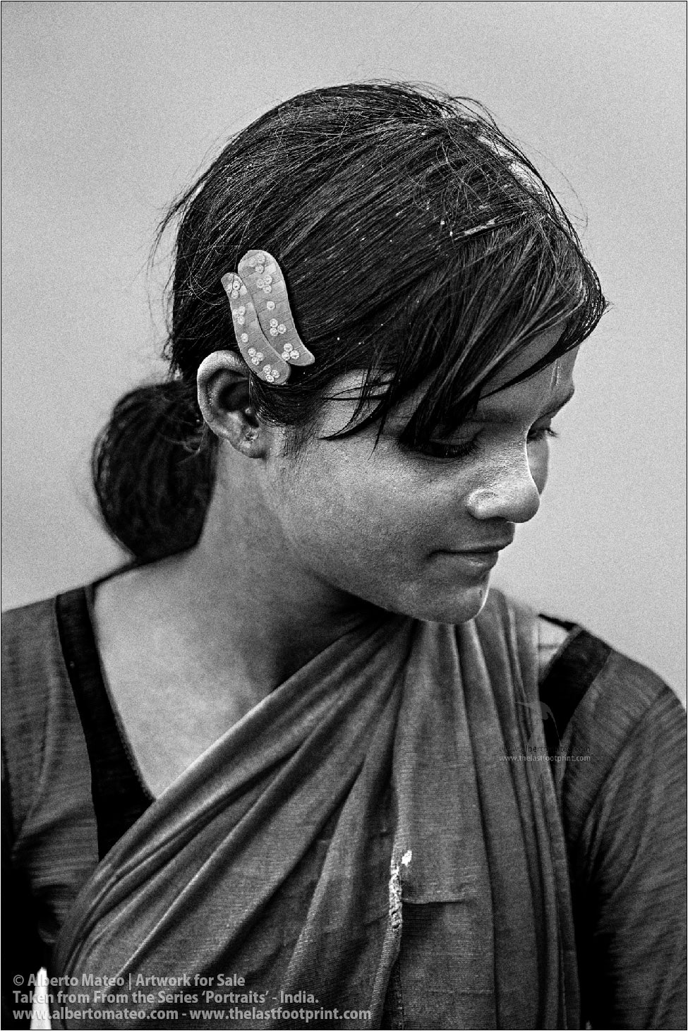 Portrait of clothes stone washer girl, Jharkhand, India.