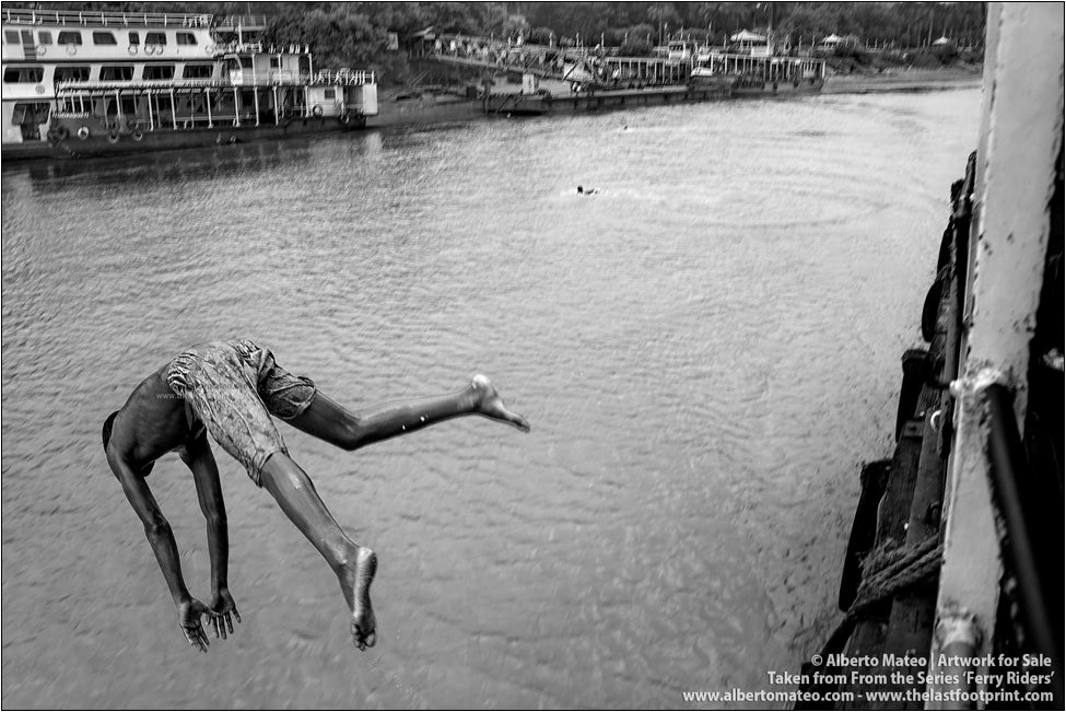 Young Boy diving on Hooghly River, Kolkata, India.