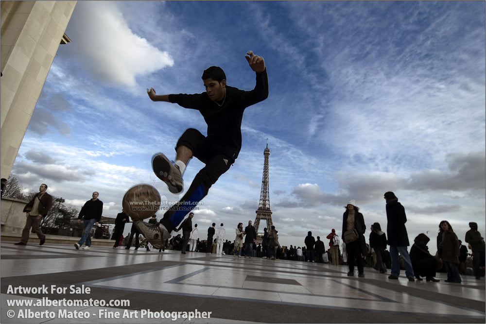 Boys playing soccer near Eiffel Tower, Paris, France. | By Alberto Mateo.