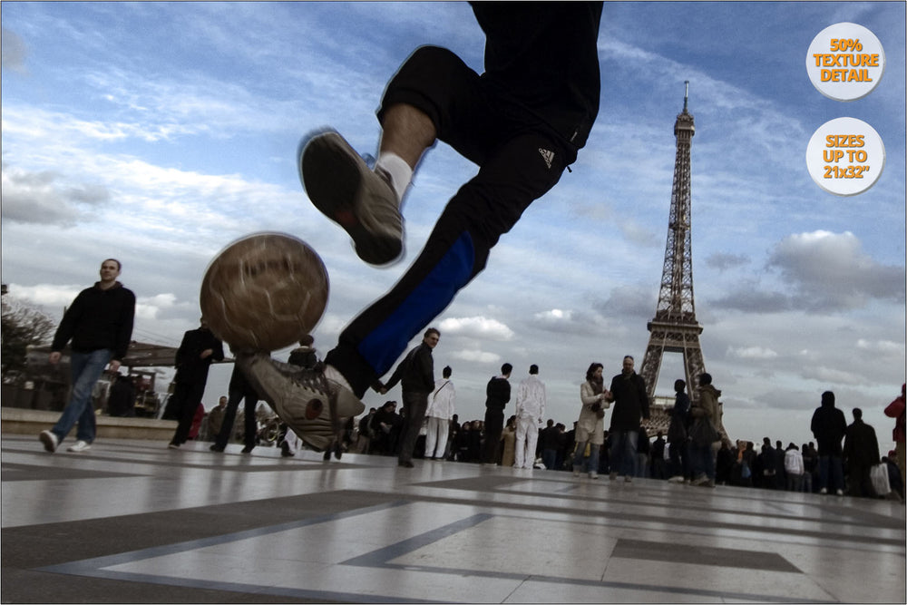 Boys playing soccer near Eiffel Tower, Paris, France. | 50% Detail.