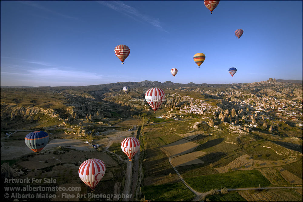Balloons over rock formations, Cappadocia, Turkey, by Alberto Mateo.