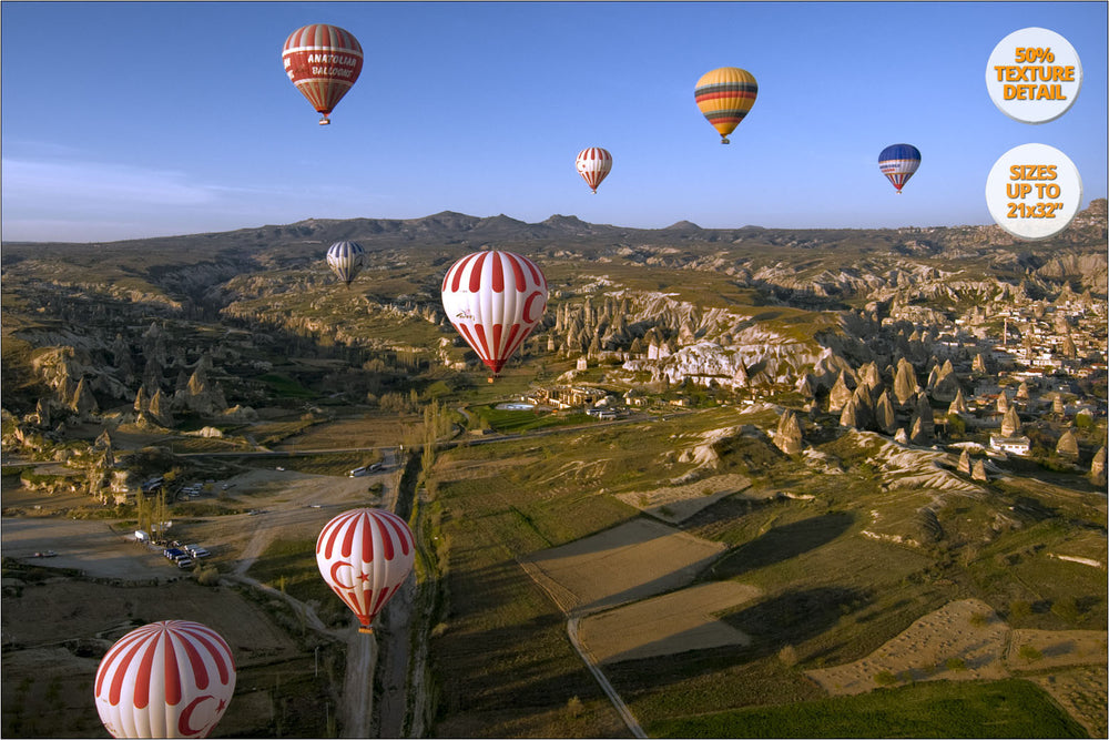 Balloons over rock formations, Cappadocia, Turkey.