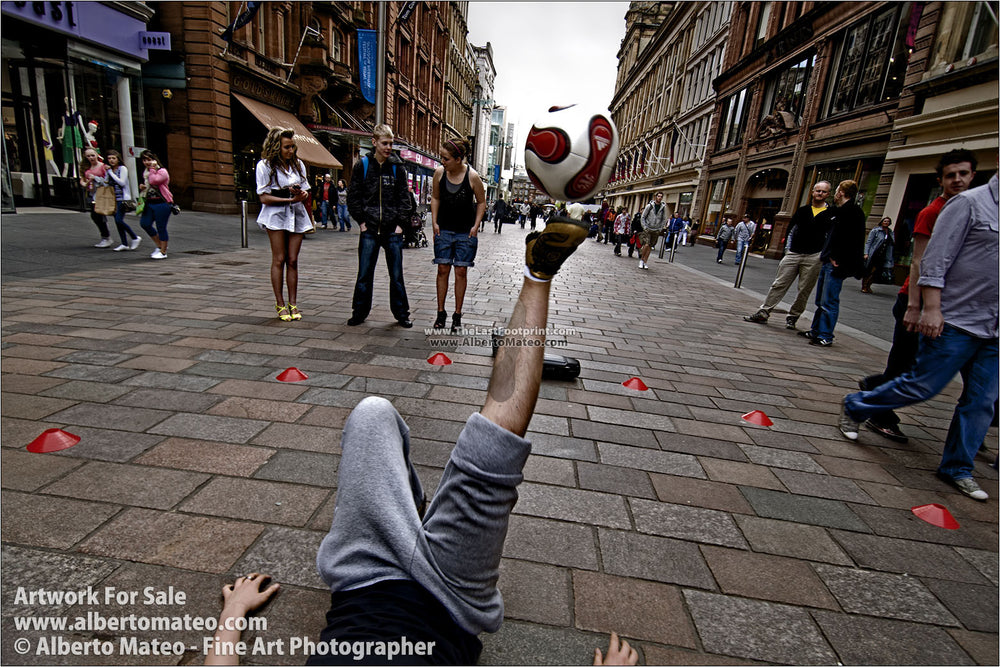 Football juggler exhibition in Glasgow, Scotland. | Open Edition Print.