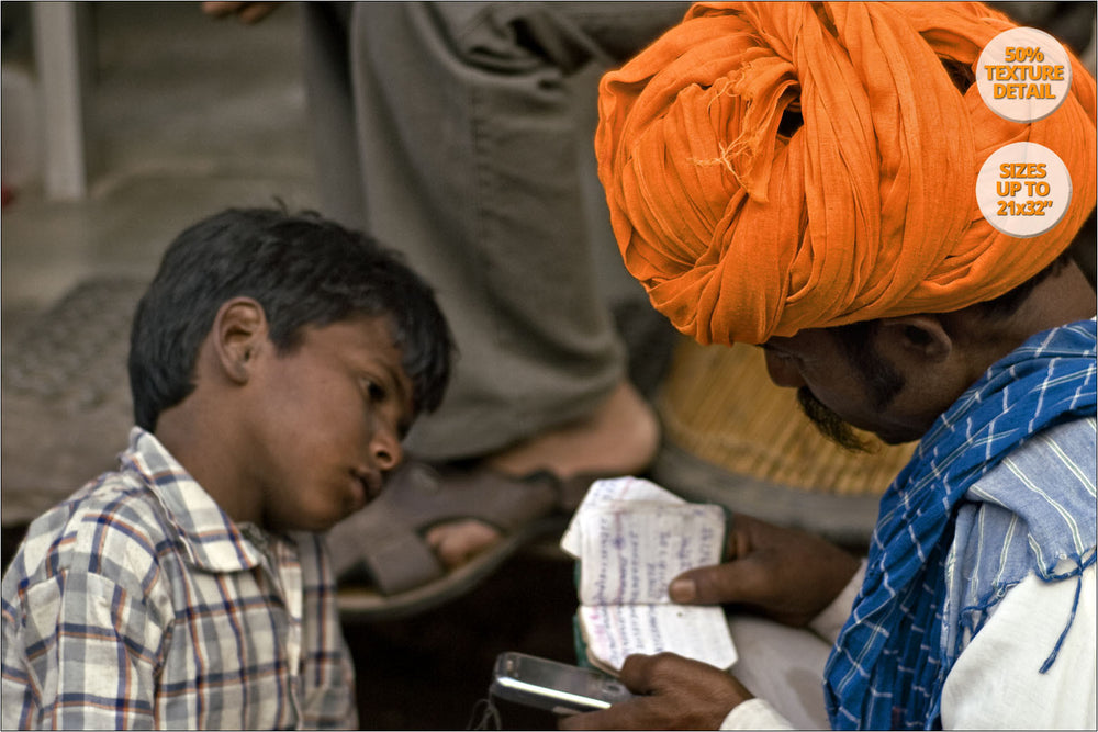 Man and son with agenda, Pushkar Camel Fair. | View of the Print at 50% magnification detail.
