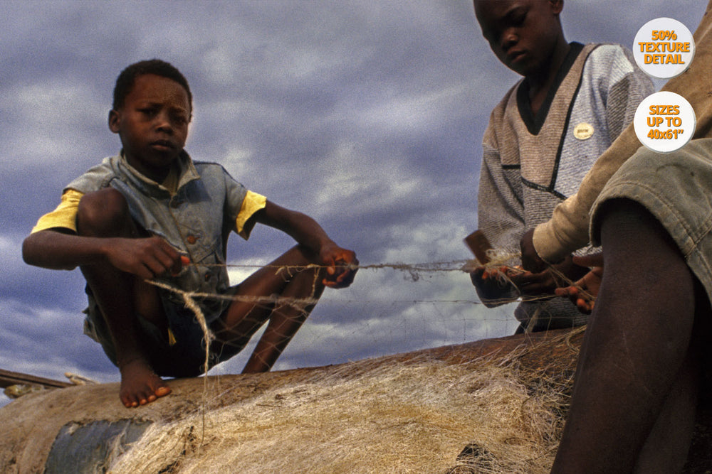 Children repairing nets, Cape Mclear, Malawi. | Detail.