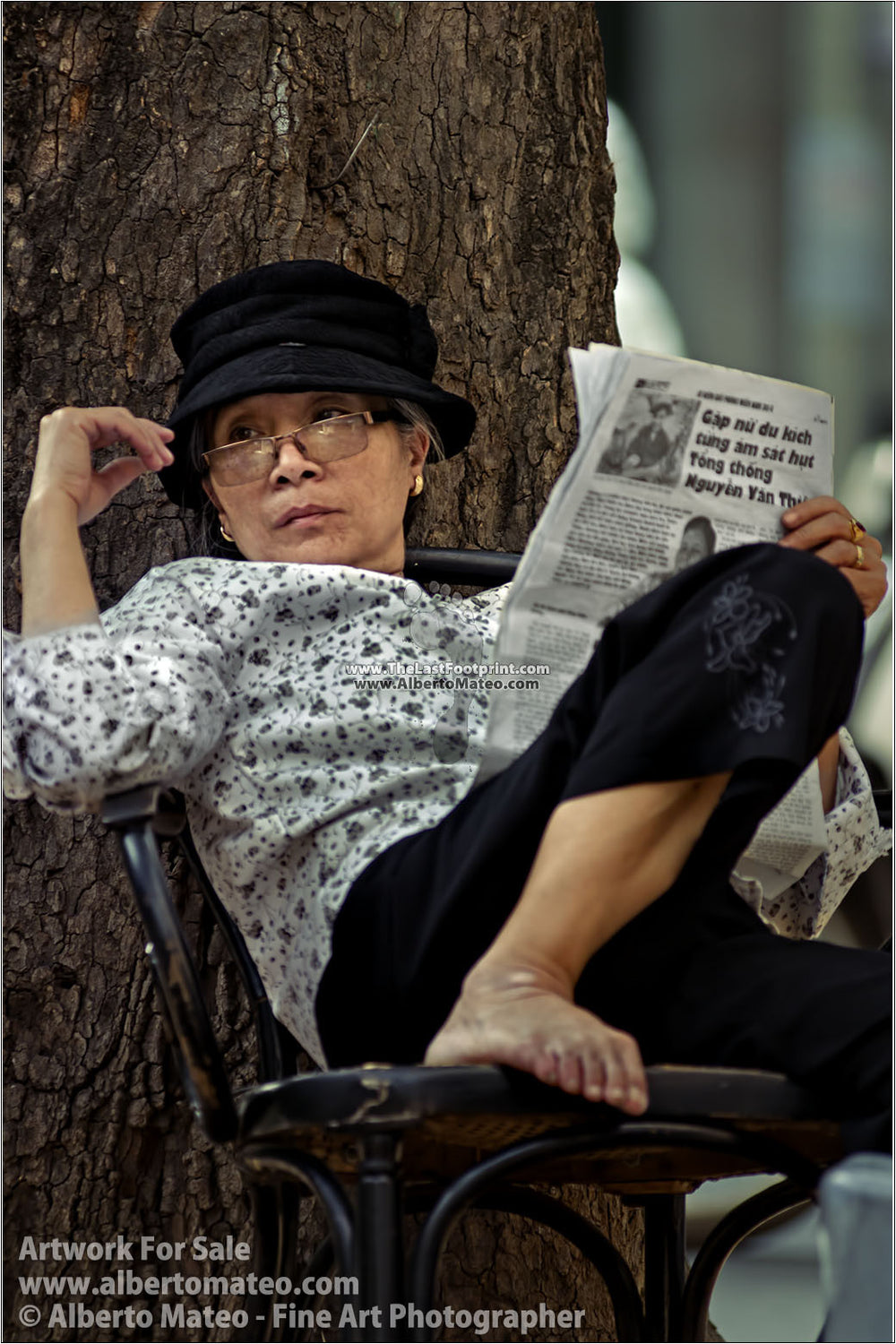 Woman reading the newspaper, Hanoi, Vietnam. | Unlimited Edition Fine Art Print.