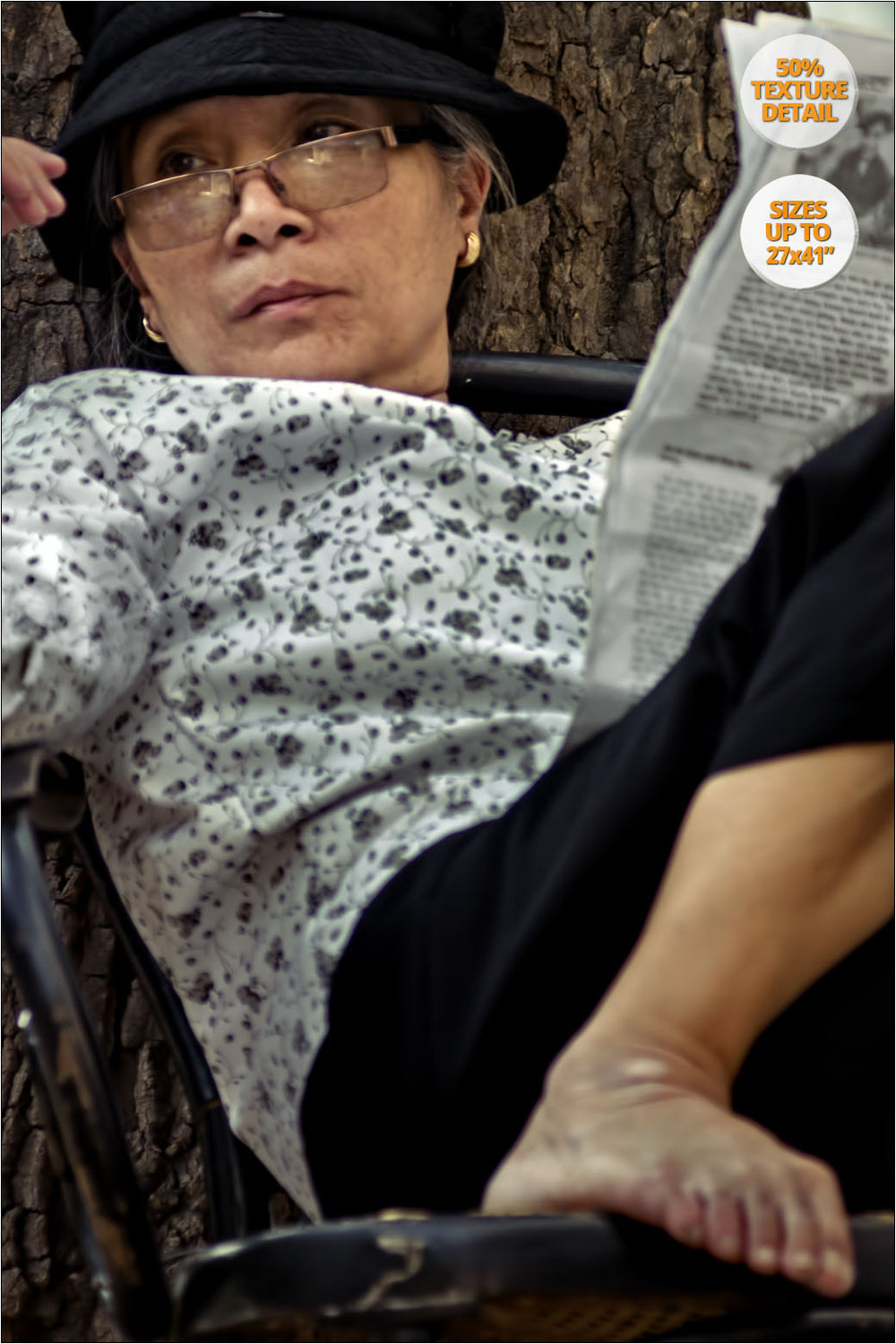 Portrait of woman reading the newspaper, Vietnam. | 50% Magnification Detail.