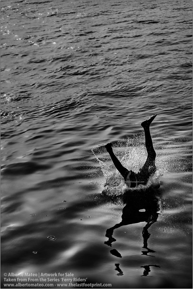 Detail of diving boy, Kolkata, India.
