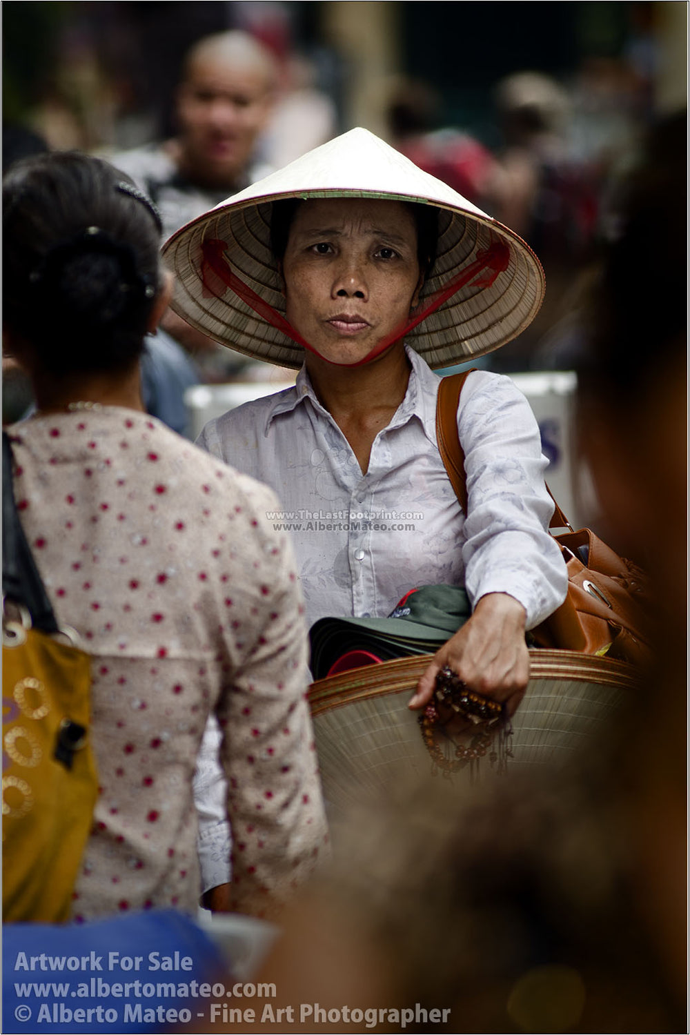 Woman selling hats in Hanoi, Vietnam. | Open Edition Print.